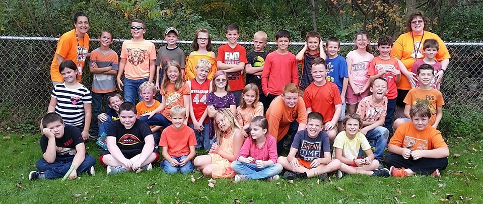 Fourth-graders wear orange in support of MS on 'Awareness Day'