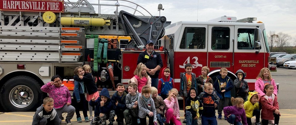 Local firemen teach fire safety lessons to elementary students