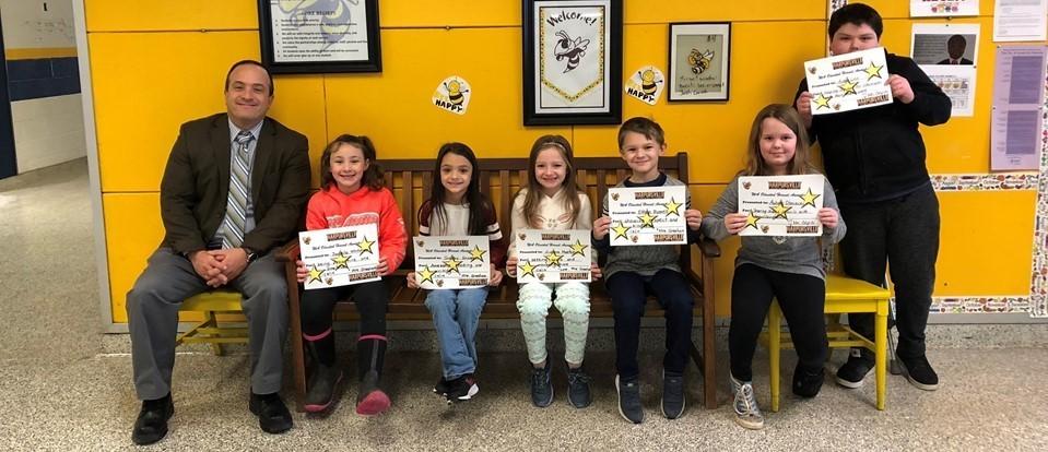 kids holding awards