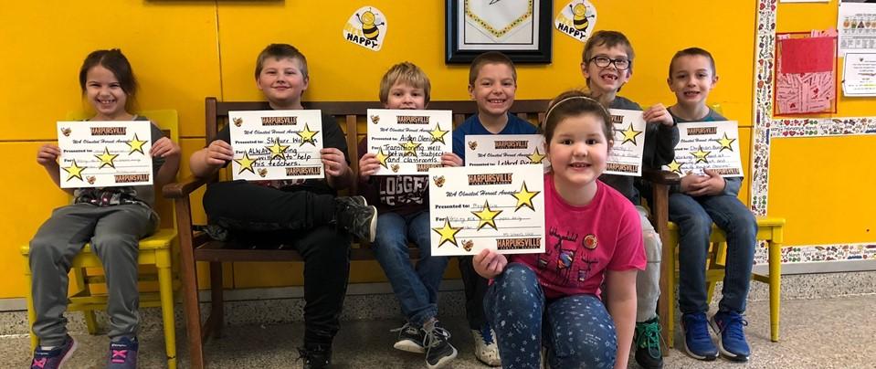 kids holding certificates